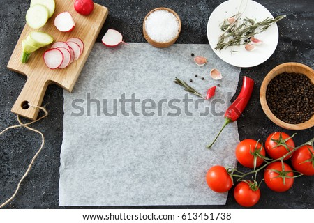 Composition of green and red vegetables on a dark background with space for text. Good for advertising posters and magazines. #613451738