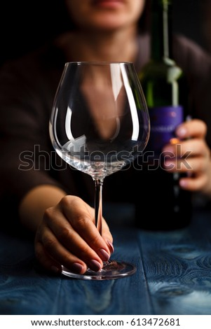 woman in depression, drinking alcohol on dark background #613472681