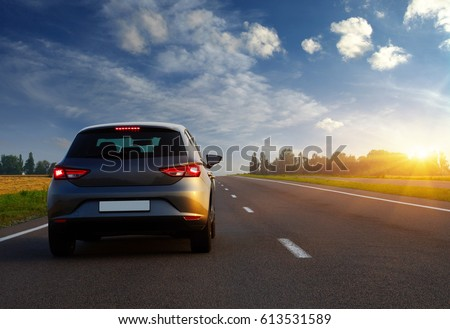 Car and light on the road. #613531589