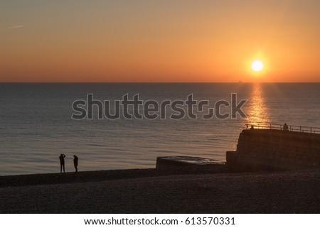 12/01/2016 Brighton, UK. Brighton beach at sunset #613570331
