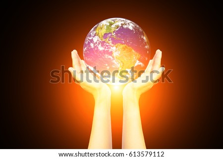 Earth in the hands isolated on black background. Space art. Astronomy and science concept. Earth day theme,Hand with planet earth,Elements of this image furnished by NASA. #613579112