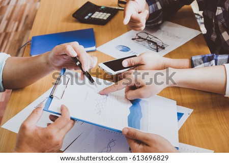 Business people brainstorming at office desk, they are analyzing #613696829