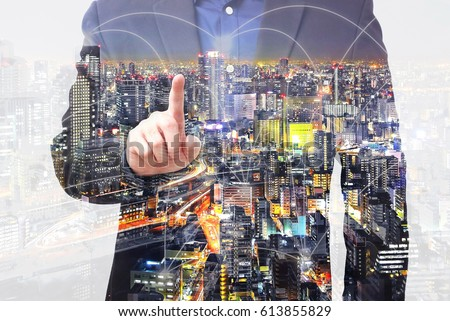 Double exposure businessman use finger touching on screen with connected city overlay  #613855829