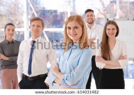 Young woman with group of people on background #614031482