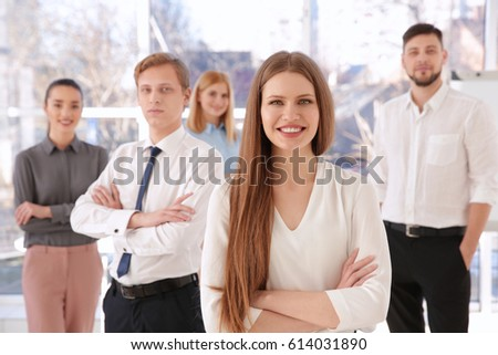 Young woman with group of people on background #614031890