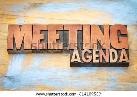 meeting agenda banner in letterpress wood type against grunge wooden background #614109539
