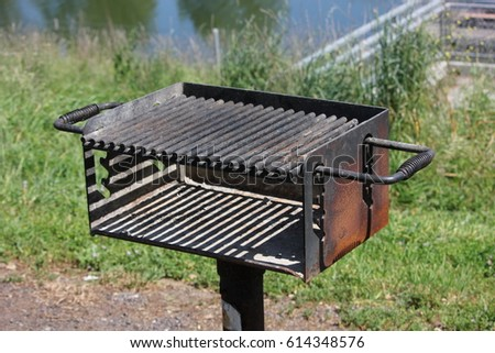 Outdoor charcoal BBQ in a park #614348576