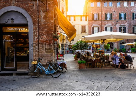 Old cozy street in Lucca, Italy. Lucca is a city and comune in Tuscany. It is the capital of the Province of Lucca. Royalty-Free Stock Photo #614352023