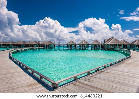 Beautiful beach with water bungalows at Maldives #614460221