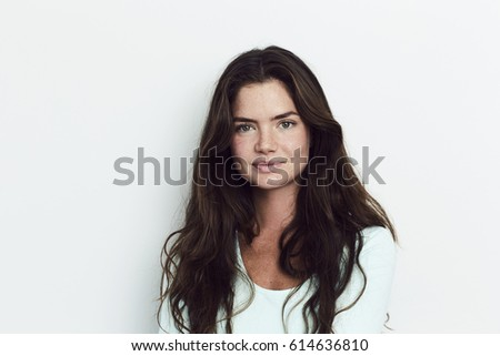 Beautiful woman in portrait, smiling #614636810