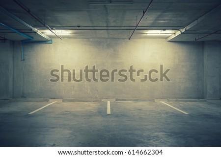 Parking garage department store interior with blank billboard #614662304