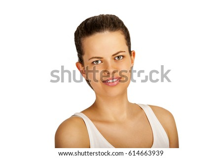 Young woman smiling, isolated over white background. #614663939