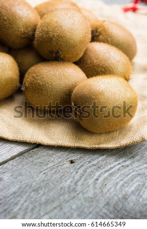 Juicy kiwi fruit on wooden background, room for text. selective focus  #614665349