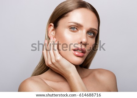 Beauty portrait of model with natural make-up. Fashion shiny highlighter on skin, sexy gloss lips make-up #614688716