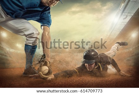 Baseball players in game action under stadium light. Sport activity people playat sunny day. #614709773