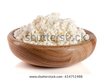 Cottage cheese in a wooden bowl isolated on a white background #614751488
