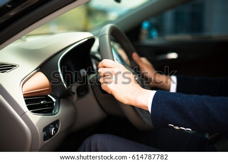 Close-up of a man's hand holding a handle/right attitude of driving/side view of a car driver #614787782