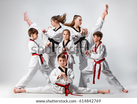 The studio shot of group of kids training karate martial arts #614842769