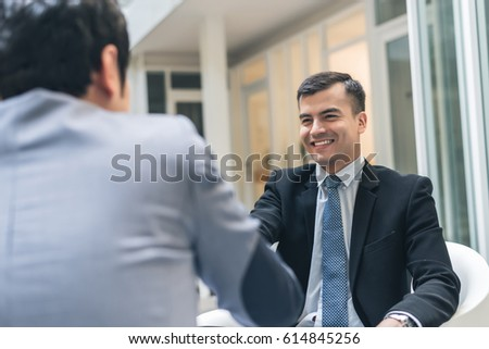business people shake hand in the outdoor #614845256