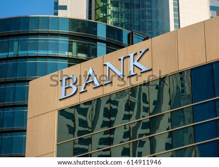 Bank sign on glass wall of business center Royalty-Free Stock Photo #614911946