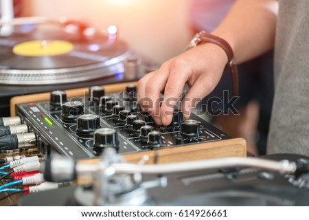 Dj play music at hip hop party.Turntable vinyl record player,analog sound technology for disc jockey to scratch vinyl records and mix tracks #614926661