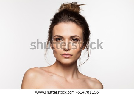 Young charming woman close-up on a white background #614981156