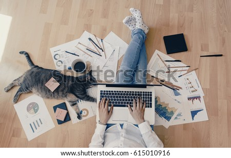 Working home concept - girl with smart phone, laptop and business reports. #615010916
