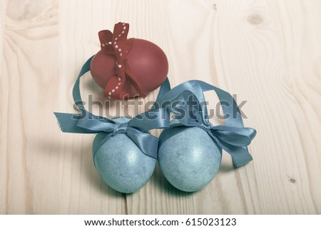 Easter composition on light wooden background. Toned. #615023123