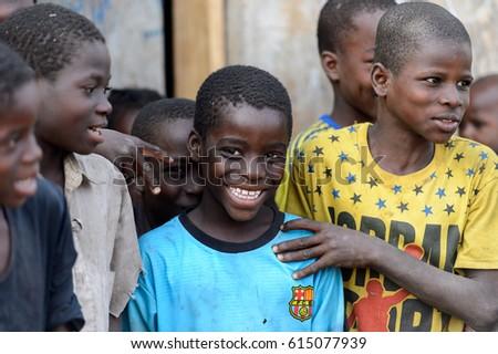 DAGOMBA VILLAGE, GHANA - JAN 14, 2017: Unidentified Dagomban boys in the local village. Dagombas are ethnic group of Northern Ghana #615077939