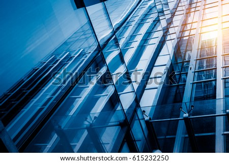 Urban abstract - windowed corner of office building  #615232250