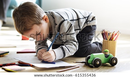 Little Kid Drawing Sketching Cute Adorable Royalty-Free Stock Photo #615355436