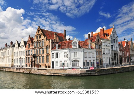 August 19, 2013. Canal and old houses in Bruges (Brugge) Belgium. #615381539