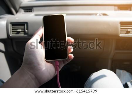Men are using phone in car #615415799