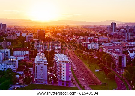 Panorama of the Zagreb capitol of Croatia. Sunset lens flares. #61549504