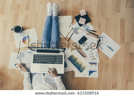 Home workplace concept - girl working with reports and having a coffee. #615508916