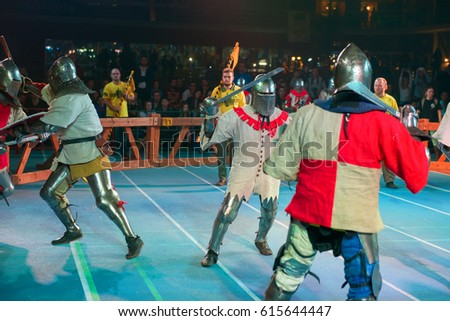 "MOSCOW - DECEMBER 03, 2016: Armored fighters , dressed as knights, fighting at the XI World championship in Medieval combat CUP ""DYNAMO"". in the Olympic Center. Znamensky #615644447"