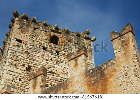 Detail of Italian ruins in the near of Lake Garda against a blue sky #61567618