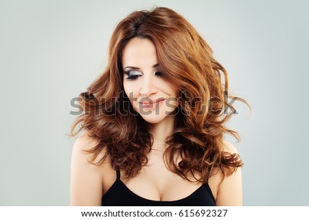 Cute Fashion Model with Red Hair Looking Down #615692327