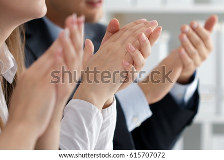 Close up view of business seminar listeners clapping hands. Professional education, business meeting, presentation or coaching concept #615707072