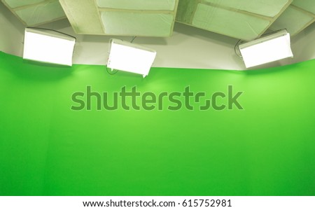 Modern TV Studio Green Screen chroma key background with camera and Light Equipment