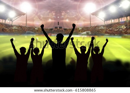 silhouettes of Soccer fans in a match and Spectators at football stadium #615808865