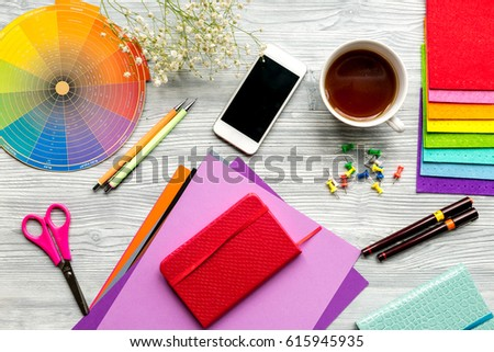 professional creative graphic designer desk on wooden background top view #615945935