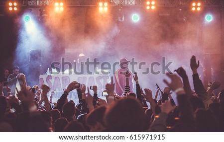 MOSCOW-15 MAY,2016:Rap music concert.crowd wave hands to singer Asap Nast performing live in nightclub.Hip hop music party #615971915