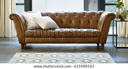 Spacious bright sunny living room interior with a comfortable sofa. Beautiful Living Room in Luxury Home. #615988181