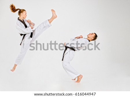 The karate girl and boy with black belts #616044947