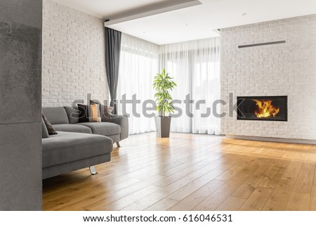 Living room with wood flooring, fireplace and sofa #616046531