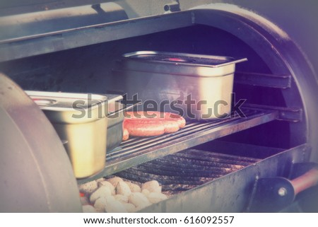 Hot dogs cooking on a bbq at a market #616092557