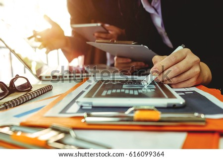 Business team meeting. Photo professional investor working new start up project. Finance task.Digital tablet docking keyboard laptop computer smart phone in morning light  #616099364