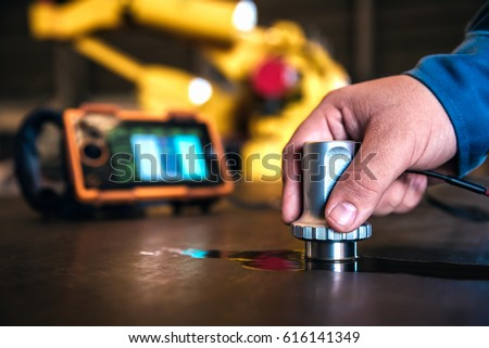 Ultrasonic test to detect imperfection or defect of steel plate in factory, NDT Inspection. Royalty-Free Stock Photo #616141349
