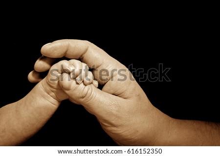 newborn trusts in adult hand #616152350